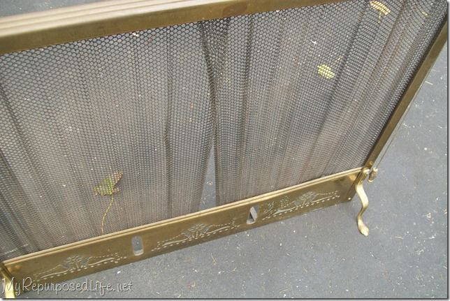 I got this ugly brass fireplace screen at a thrift store for $4. I used spray paint to give it a great new look for my fireplace. Easy spray paint projects